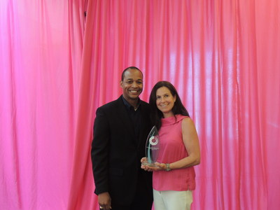 Dr. Christine Alavrado, Novus Teaching Award recipient, with Dr. Kendre Stringfellow, Novus Technical Service Manager. (PRNewsFoto/Novus International, Inc.)