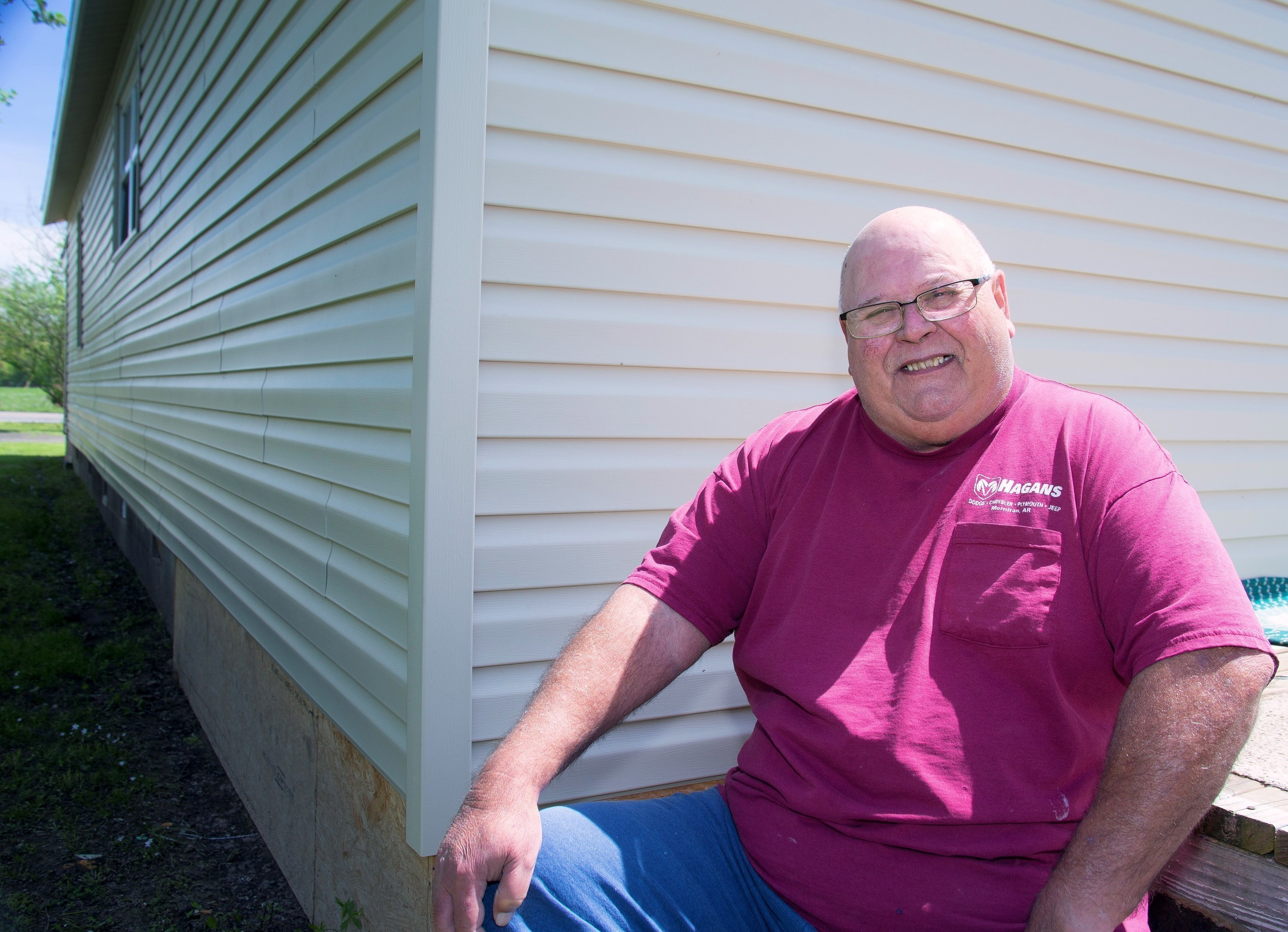 Kenneth Hinkston's home in Atkins, Arkansas received a new roof and new siding with the help of a Special Needs Assistance Program (SNAP) grant from River Town Bank and the Federal Home Loan Bank of Dallas. For information about SNAP grants, contact River Town Bank.