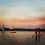 Warriors and their families enjoy a picturesque evening on the water, at an event hosted by Wounded Warrior Project.