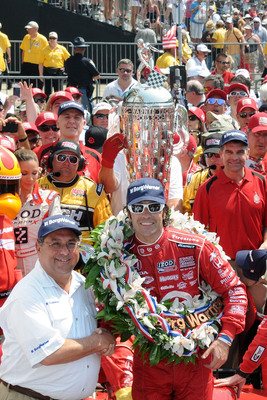 Standing beside the Borg-Warner Trophy(TM) in Victory Lane, BorgWarner Chairman and CEO Tim Manganello congratulated Dario Franchitti on his third victory at the Indianapolis 500. Photo courtesy of Rob Banayote. (PRNewsFoto/BorgWarner Inc., Rob Banayote)