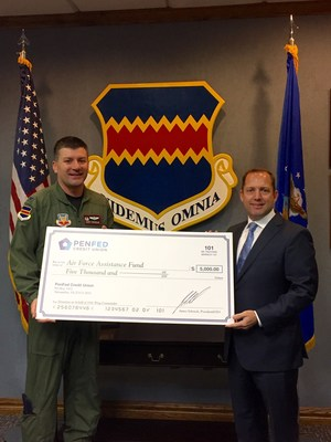 Commander of the 55th Wing, Col. Marty Reynolds, and PenFed President and CEO James Schenck