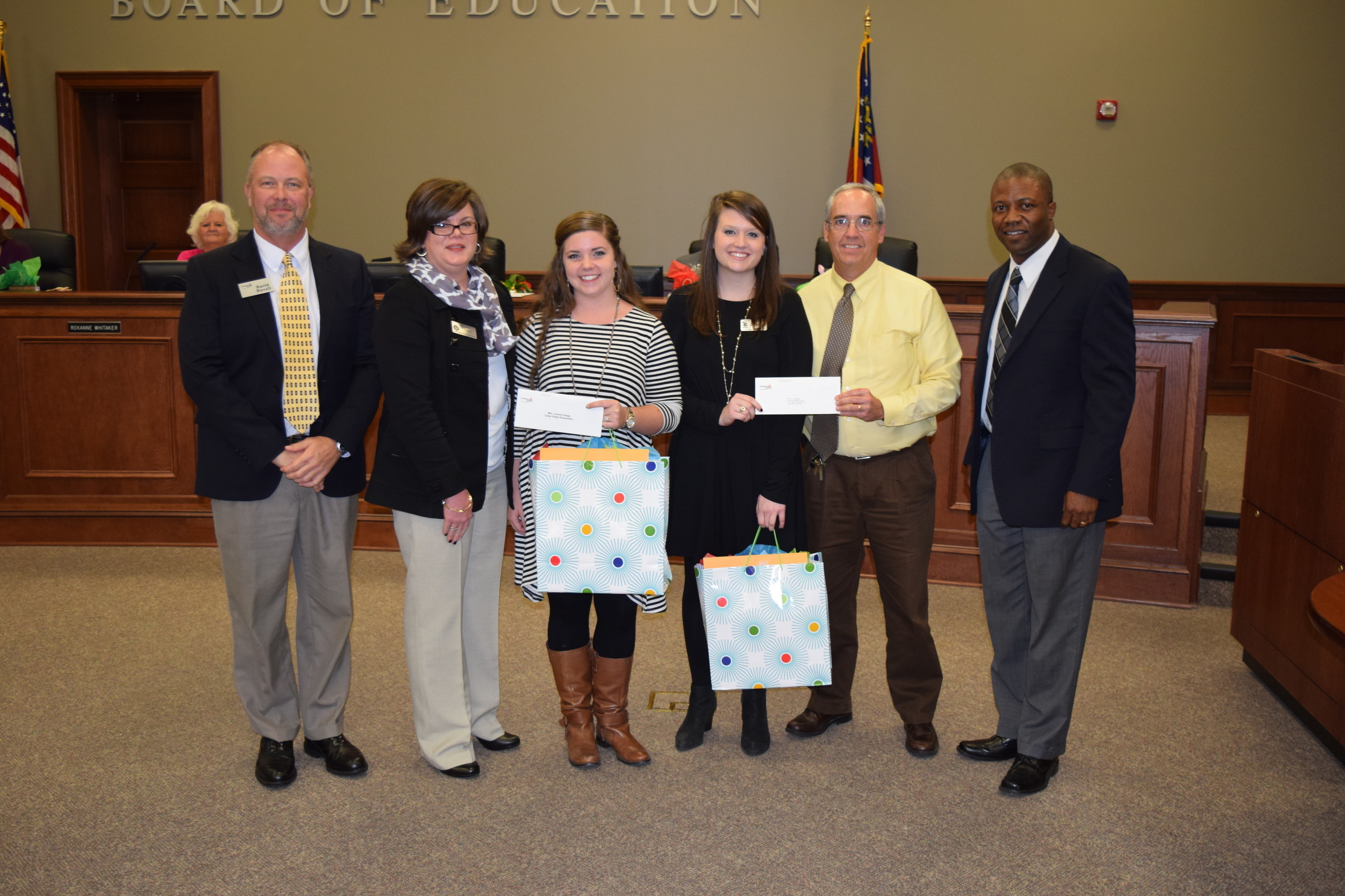Georgia Power New Teacher Assistance Grant recipients, Brooke Byrd and Erin Wedereit, accepts their grants during a presentation at the Columbia County Board of Education meeting.