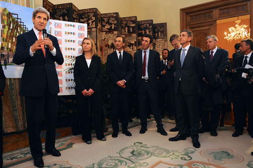 U.S. Secretary of State John Kerry, flanked by Italian Foreign Minister Federica Mogherini and leaders of U.S. ...