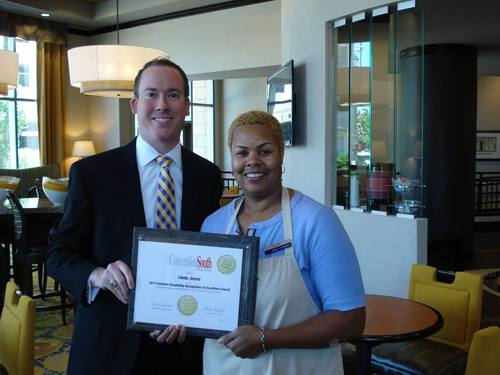 Hampton Inn & Suites Baton Rouge Downtown J. Benjamin Blackwell, General Manager and top honoree Linda Jones (PRNewsFoto/Hampton Inn & Suites Baton Rouge)