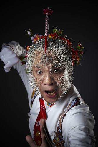 "In this jaw-dropping picture from Guinness World Records 2011, Wei Shengchu poses after earning the record for ""Most Needles in the Head"". Shengchu had 2,009 needles inserted into his head on the set of the Lo Sho dei Record in Milan, Italy. Photo Credit: Paul Michael Hughes/Guinness World Records. (PRNewsFoto/Guinness World Records, Paul Michael Hughes)"