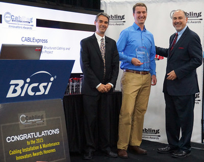 Josh Taylor (center), senior product manager at CABLExpress, accepts the Cabling Innovators Award from Cabling Installation & Maintenance's Patrick McLaughlin (left), chief editor, and Alan Bergstein (right), group publisher. Taylor accepted the award on behalf of the CABLExpress and WellSpan Health Structured Cabling and Network Visibility Project at the BICSI Fall Conference on Monday, September 21, 2015.