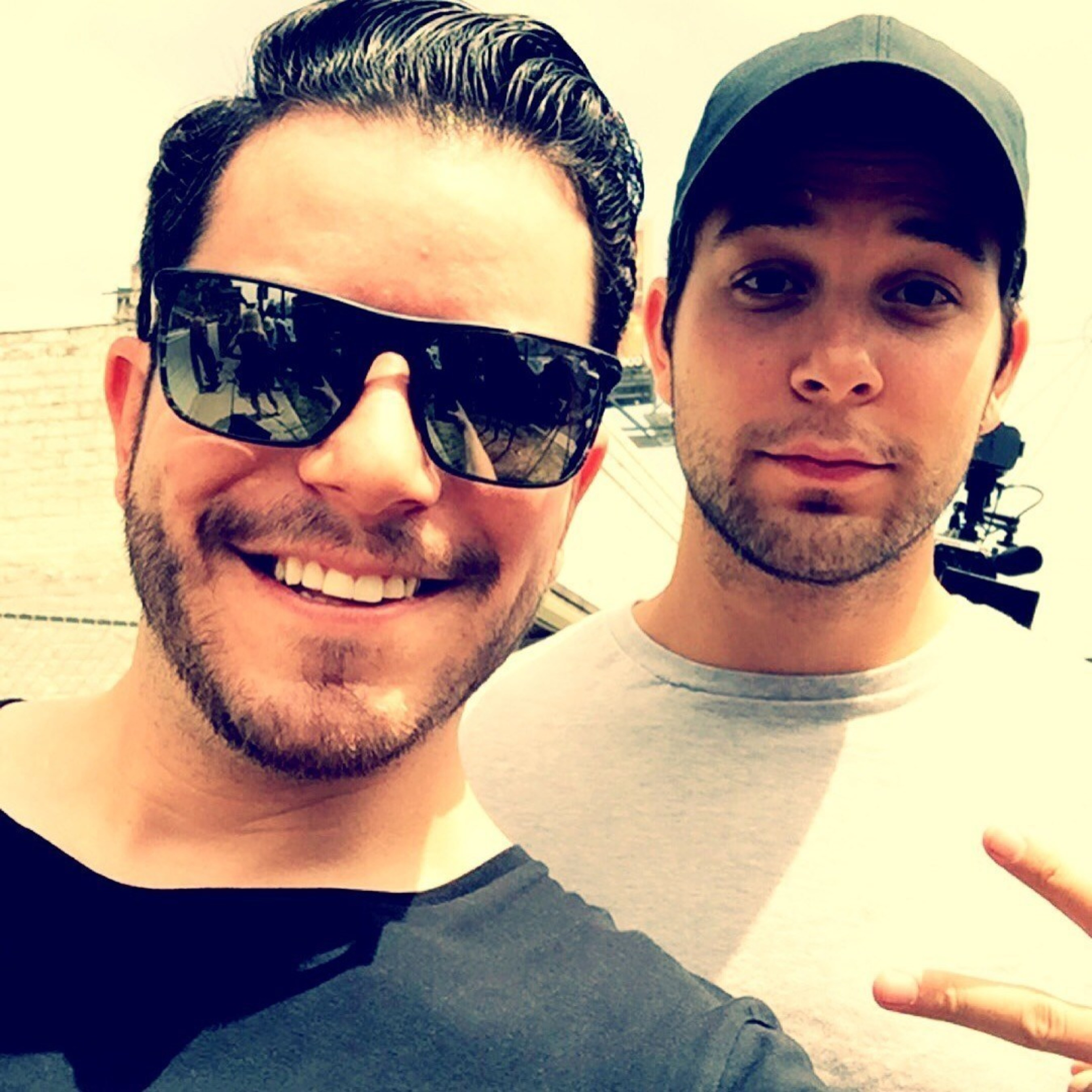 Grungy Gentleman founder Jace Lipstein, wearing the Flat Island sunglass from Maui Jim, shown here with his brother, actor Skylar Astin.