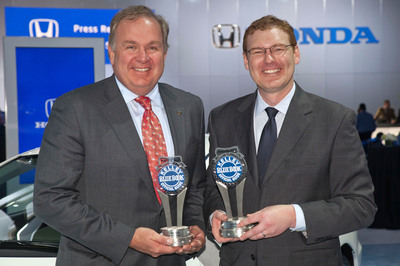 American Honda Executive Vice President of Sales John Mendel (left) accepts two Kelley Blue Book Brand Image Awards from Kelley Blue Book President Jared Rowe at the 2012 New York Auto Show.  (PRNewsFoto/American Honda Motor Co., Inc.)