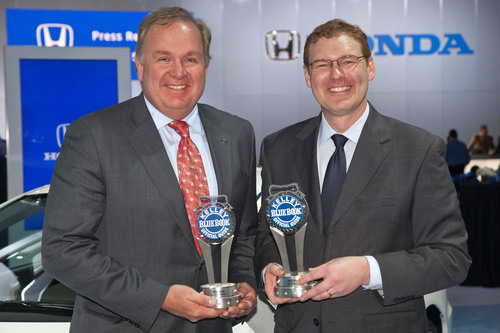 American Honda Executive Vice President of Sales John Mendel (left) accepts two Kelley Blue Book Brand Image ...