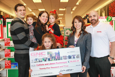 'ME ON GNC' Photo contest winners Jason, Lucy, Callista, Cece and Bella Puchmeyer with GNC's Erin Catalina, Director of Social Media and John Petzker, Regional Sales Director. (PRNewsFoto/GNC Holdings, Inc.) (PRNewsFoto/GNC HOLDINGS, INC.)