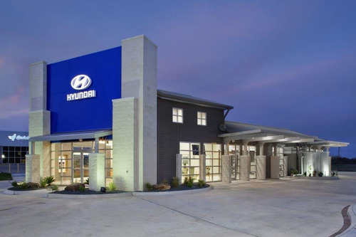 Hyundai of Brenham's exterior shows the extensive use of recycled materials used during construction. The water collection and recycling system can be seen near the rear of the building on the right.  (PRNewsFoto/Hyundai Motor America)