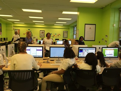 Volunteers and students enjoy their exposure to STEM fundamentals at Digital Girl, Inc. in Bedford-Stuyvesant.  CipherHealth recently raised money to support the great work being done by Digtial Girl to inspire children about careers in science, technology, engineering and math (STEM).
