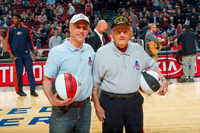 """Father and son U.S. Army veterans Edward and Jerry Pasierb were honored at the Nov. 8, 2012 Chicago Bulls game through BMO Harris Bank's """"Military Moments"""" program.  (PRNewsFoto/BMO Harris Bank)"""