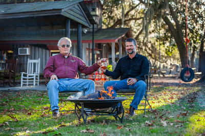 Light it up! Firefly Distillery co-founders, Jim Irvin and Scott Newiit introduce Firefly Moonshine.  (PRNewsFoto/Firefly Distillery)