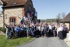 Employees of Oxford PharmaGenesis celebrating in the sunshine at the company's headquarters in Oxford