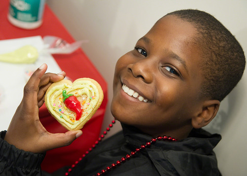 Eric, a patient at St. Jude Children's Research Hospital, shows off the cookie he decorated during ...