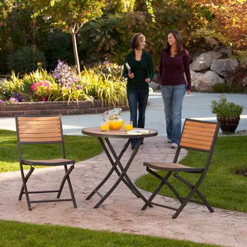 "The Lifetime 3-Piece Bistro Set offers the warm beauty of a wood-looking bistro set that is maintenance-free. This cozy dining setting for two features a 29.5"" round folding table and two folding chairs - which are all constructed of heavy-duty simulated wood made from high-density polystyrene plastic. The simulated wood has the color and texture characteristics of natural wood grain so that it both looks and feels like real wood. The Lifetime Bistro Set is weather-resistant and will not splinter, warp, and never needs to be painted or ..."