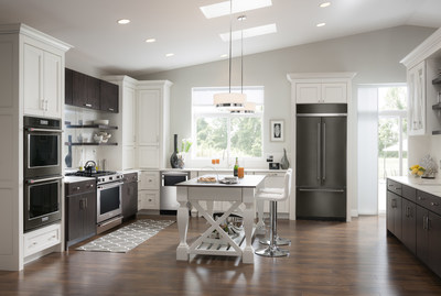 KitchenAid black stainless steel appliances with light cabinets.