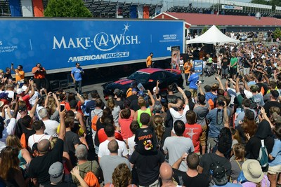 Steve Voudouris, president of AmericanMuscle.com, unveils the dream car of Johnathan Mullins -- in partnership with Make-a-Wish.