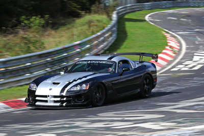 On Sept. 14, 2011, veteran GT driver Dominik Farnbacher pilots the street-legal 2010 Dodge Viper SRT10 ACR to a new production car lap record of 7:12.13 at the famed 12.9 mile Nurburgring Nordschleife (north course).  (PRNewsFoto/Chrysler Group LLC)