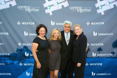 Cancer Center of Santa Barbara with Sansum Clinic Gala Co-Chairs Christy Kolva, Tracie Fiss and Julie Nadel with Jay Leno.  (PRNewsFoto/Sansum Clinic)