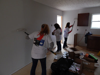 Volunteers help paint two Twinsburg Habitat for Humanity homes.