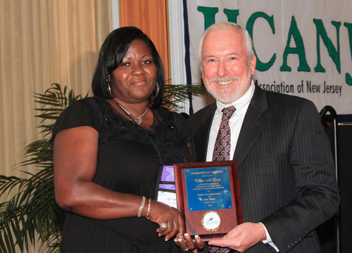 Valerie McCants of Van Dyk Health Care, Inc. receives 'Caregiver of the Year' award from Paul Langevin,  ...