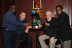 Coach Don Shula (second from right) and 1972 Miami Dolphins players (L to R) Larry Little, Earl Morrall, and Mercury Morris, toast to celebrate the 40th anniversary of the Perfect Season at the Shula's Steak House located in the Walt Disney World Swan and Dolphin Hotel. A customized sugar-sculpture was created by world champion pastry chef Laurent Branlard to honor the occasion.  The restaurant, which hosted a celebratory meet-and-greet with the coach and the players, is themed after the undefeated season.  (PRNewsFoto/Walt Disney World Swan and Dolphin Hotel)