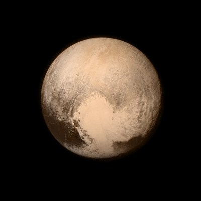 """This is the last and most detailed image sent to Earth before NASA's New Horizons spacecraft's closest approach to Pluto later today. The image was taken on July 13 from the Long Range Reconnaissance Imager aboard the spacecraft, The color image has been combined with lower-resolution color information from the Ralph instrument built by Ball Aerospace.  This view is dominated by the large, bright feature informally named the """"heart,"""" which measures approximately 1,000 miles (1,600 kilometers) across."""