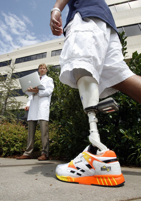 Orthocare Innovations researcher and prosthetist Jay Martin, CP, FAAOP, uses the da Vinci Award winning Compas(TM) and Smart Pyramid(TM) to provide an amputee with optimal prosthetic alignment.  (PRNewsFoto/Orthocare Innovations, Steve Sisney)