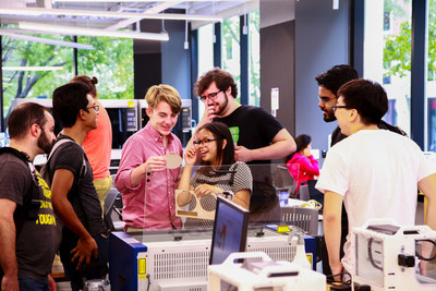 NYU Tandon student Madeleine Nicolas demonstrates the Epilog Mini 24 Laser Cutter to other students at the new NYU Tandon MakerSpace in Downtown Brooklyn. A commercial-grade laser cutter is also available to students after specialized training.