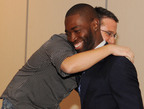 Renowned playwright Tarell Alvin McCraney (NWSA theater 1999) shares a moment with film maker Billy Corben (NWSA theater 1996) during the reception at Jungle Island after his welcoming address.  (PRNewsFoto/New World School of the Arts)