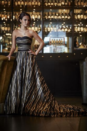 "TV star Lucy Watson is as much Maid in Cheddar as Made in Chelsea as she models a stunning ÂPounds Sterling40,000 couture outfit by celebrity designer Zeynep Kartal âeuro"" inspired by a block of Pilgrims Choice cheddar cheese. (PRNewsFoto/Pilgrims Choice)"