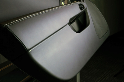 IAC debuts its innovative Smartfoil(TM) solution for the lower door panels on Chevrolet's most anticipated new vehicle, the 2014 Corvette Stingray. (PRNewsFoto/International Automotive Components (IAC)) (PRNewsFoto/INTERNATIONAL AUTOMOTIVE COM...)