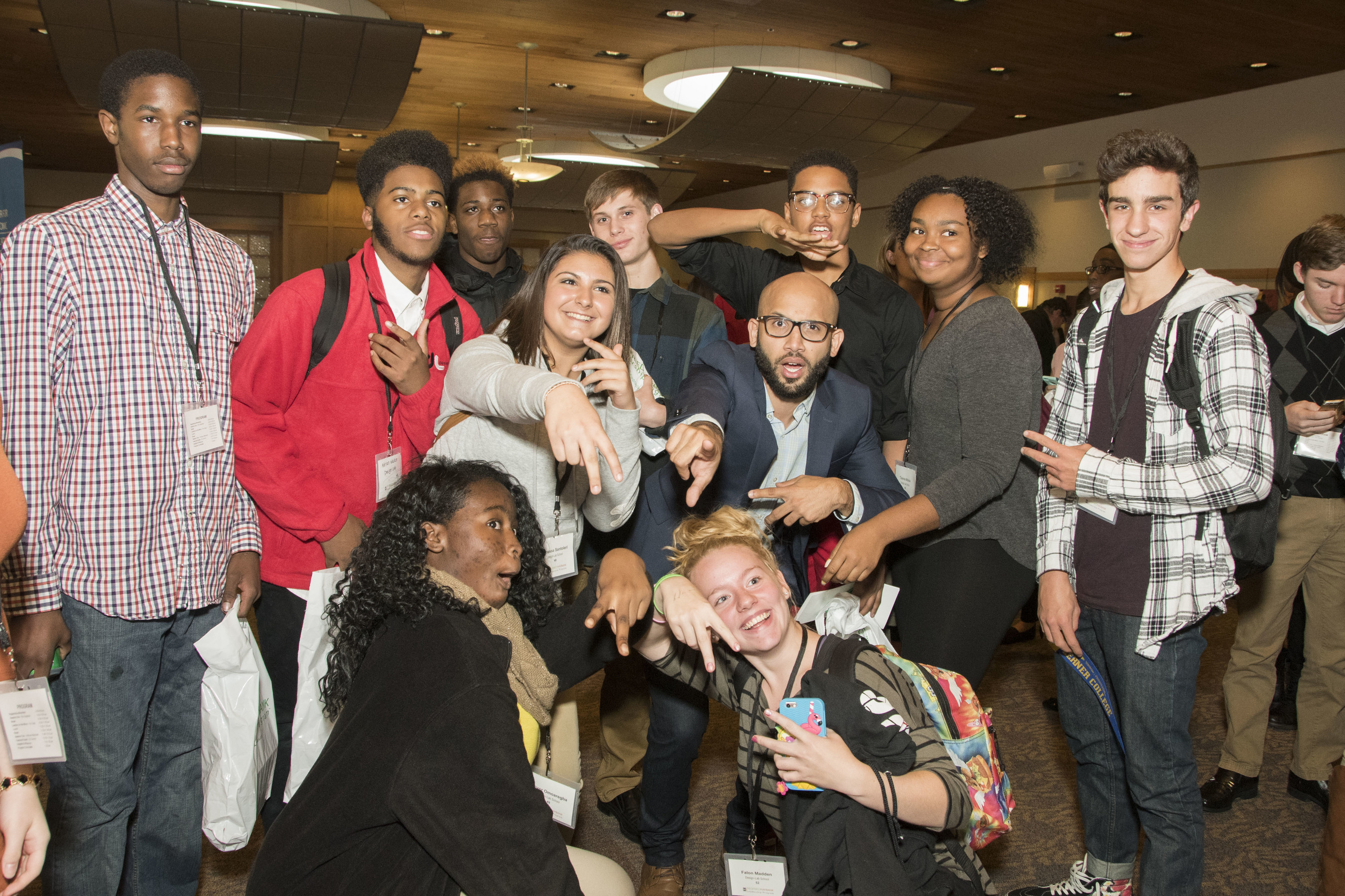 """Guest speaker EJ Carrion, CEO of Student Success Agency and best-selling author of """"Accelerate Your Success,"""" takes a group photo with student attendees."""
