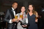 Television host AJ Calloway and Actress Jacqueline Wood host the Stella Artois World Draught Master Final and pose with winner Marjolein Geuens of Belgium. (PRNewsFoto/Stella Artois Global)