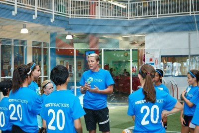Abby Wambach discussing safety technique during Triax Tec #BestPractices training session.  Triax today announced partnership with IBM Watson Ecosystem as part of concussion research and safety for players.