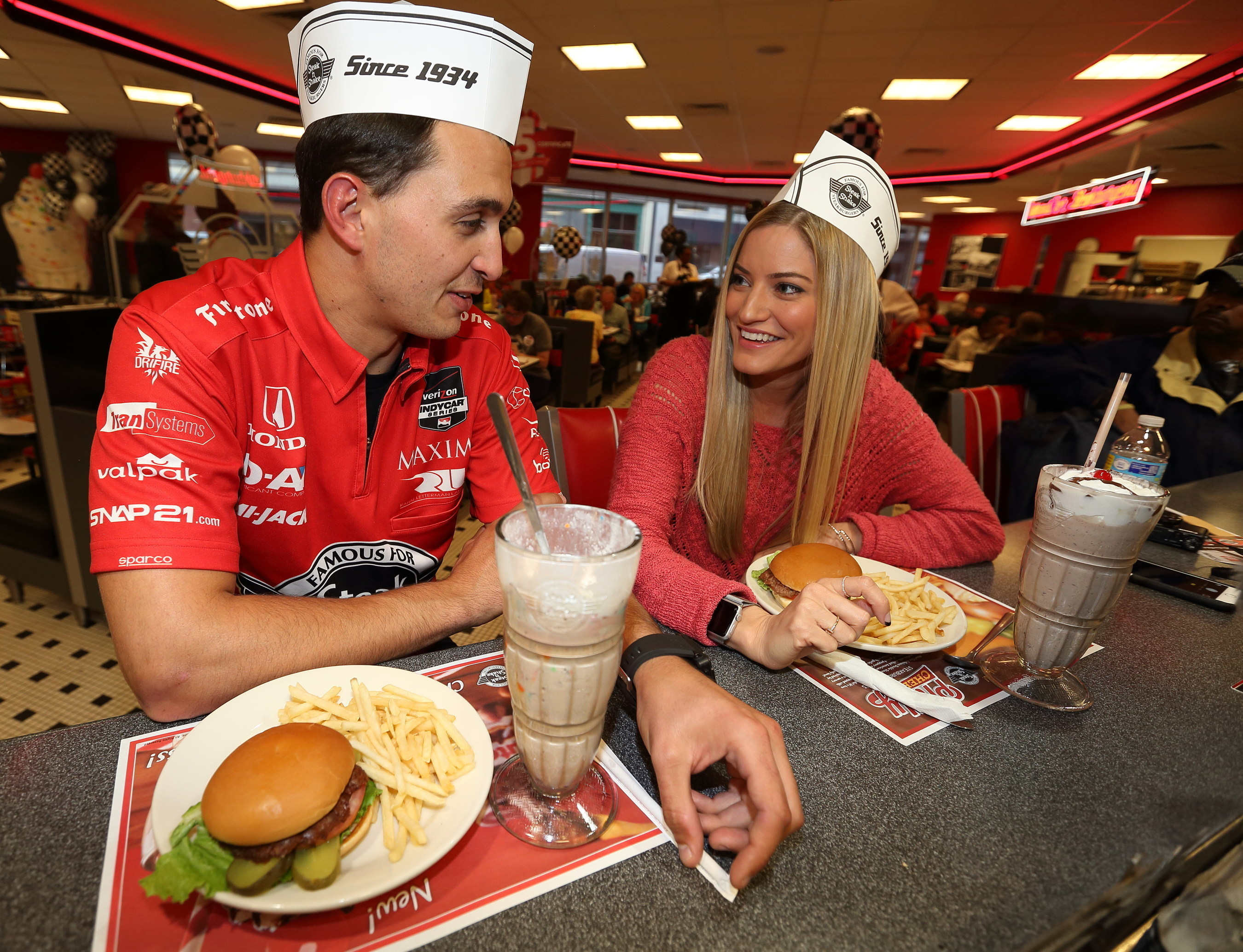 Graham Rahal, the No. 15 Steak 'n Shake Indy car driver and YouTube star iJustine enjoy milkshakes and take selfies together at an Indy 500 fan event held at the downtown Steak 'n Shake restaurant on May 21, 2015.