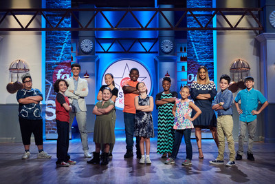 Mentors Donal Skehan and Tia Mowry with the kid competitors of Food Network's Food Network Star Kids