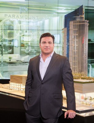 Miami Master Developer Daniel Kodsi stands next to 12 foot tall scale model of his 700-foot, 60-story, $500 million Paramount Miami Worldcenter residential skyscraper on March 3, 2016 ground breaking signaling start of construction of America's Second-Largest Urban Development, Miami Worldcenter. (Credit: World Satellite Television News).