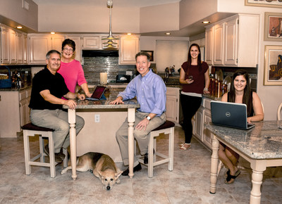 Cox President Pat Esser is a guest in the Atlas family's digital home (L to R: Steve Atlas, Alice Atlas, Dixie the dog, Pat Esser, Allison Atlas, Jenna Atlas), the first to sign up for the company's coming gigabit Internet service.