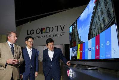 William Cho, president of LG Electronics USA, Thomas Lee, senior vice president of LG Electronics USA and Tim Alessi, director of new product development LG Electronics USA demonstrated LG's webOS  Smart TV on the first Ultra HD 4K OLED TV for the U.S. market at the CEDIA Expo 2014. (PRNewsFoto/LG Electronics USA, Inc.)