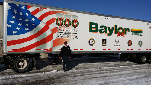 """Baylor Trucking, Inc. President, Robert Baylor presents the trailer which will be used to donate wreaths free-of-charge to military cemeteries in 2013. This is the sixth straight year Indiana's Baylor Trucking is partnering with Wreaths Across America. The mission of the program is to, """"remember the fallen, honor those who serve and teach our children the value of freedom."""" (PRNewsFoto/Baylor Trucking) (PRNewsFoto/BAYLOR TRUCKING)"""