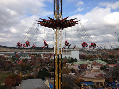 "Thirty-Two jolly Santas took the ultimate test flight on SkyScreamer, a massive swing ride at Six Flags Fiesta Texas in San Antonio.The thrillingly magical ""test flight"" was part of a Six Flags Flying Santas' Day in conjunction with its sister parks in Arlington, Texas and Vallejo, California. Santas of all shapes and sizes took in the breathtaking views high above the park's signature quarry walls in celebration of the annual Holiday in the Park event now open daily through January 5, 2014.  (PRNewsFoto/Six Flags Entertainment Corporation)"