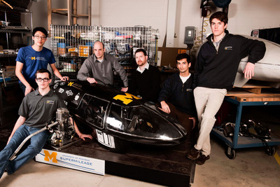 Freudenberg-NOK Sealing Technologies is sponsoring the U of M Supermileage(R) Team. The goal? 3,000 miles per gallon. From left: Andy Dun, junior, mechanical engineering; David Coons, junior, mechanical engineering; Rory Pawl, director, FNST Future Technology; Mike Rowe, FNST strategic product development manager, Technology; Karan Jain, junior, mechanical engineering; and John Rockwell, junior, mechanical engineering.  (PRNewsFoto/Freudenberg-NOK Sealing Technologies, Edward Llewellyn Ochal/TIF Photographic, LLC.)