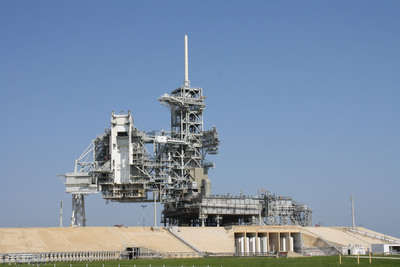 For the first time in the 50-year history of Kennedy Space Center, NASA on July 20 will begin allowing public visitors to tour one of the launch pads from which the space shuttles and Apollo Saturn V moon rockets were launched. The KSC Up-Close: Launch Pad Tour, the latest to open of three special Kennedy Space Center 50th anniversary rare-access tours, takes visitors from Kennedy Space Center Visitor Complex a quarter-mile inside the perimeter security fence for a guided walk and photo opportunity at Launch Pad 39-A.  (PRNewsFoto/Kennedy Space Center Visitor Complex)