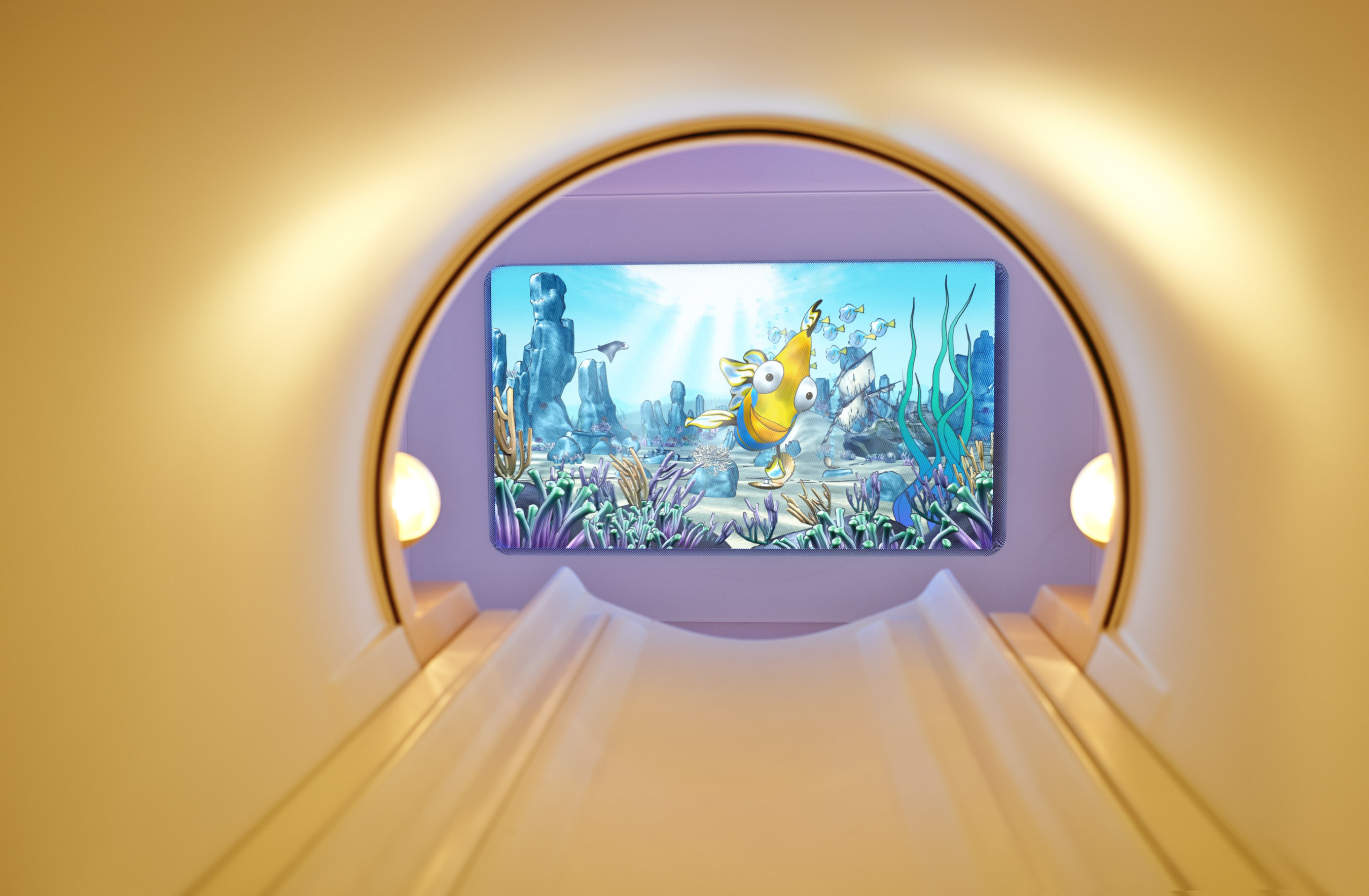 Engaging visuals are displayed on the back wall and can be seen via a mirror on the head coil, while patients ...