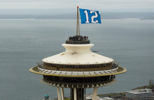 """The Seahawks """"12"""" Flag representing their fans flies atop the Space Needle and will be signed by the community and delivered to the team in New Jersey before Super Bowl XLVIII. (PRNewsFoto/Space Needle) (PRNewsFoto/SPACE NEEDLE)"""