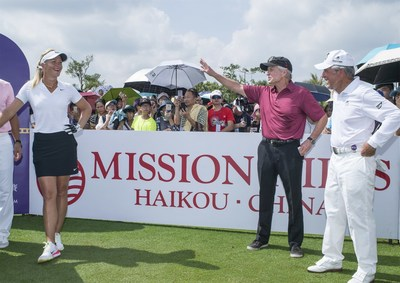 Suzann Pettersen (left) jokes with Michael Douglas and Gary Player (right) at the 1st hole during the Mission Hills World Celebrity Pro-Am