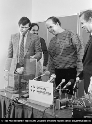 At a 1985 news conference are, from left, Robert Jarvik, Dr. Mark Levinson, heart transplant patient Michael Drummond and Dr. Jack Copeland.